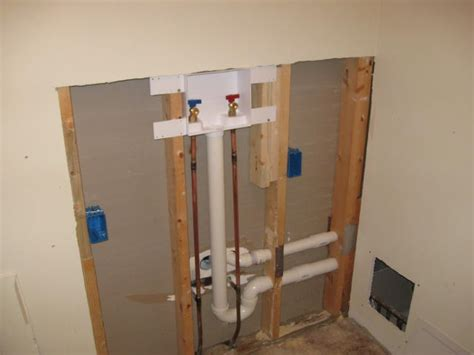 Washing Machine Plumbing Installation by Moving Washer Tapping Into Drain Pipe