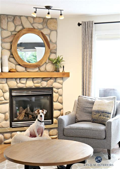 Living room with stone fireplace, Sherwin Williams Creamy