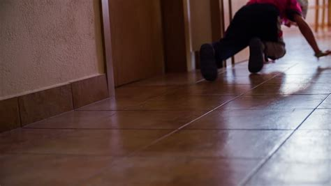 Motion On The Floor by Kid Crawling On Floor Through Hallway In Motion