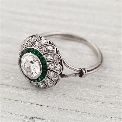 vintage 80 carat and emerald engagement ring