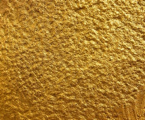 wallpaper gold stone golden stone wall texture for background stock photo