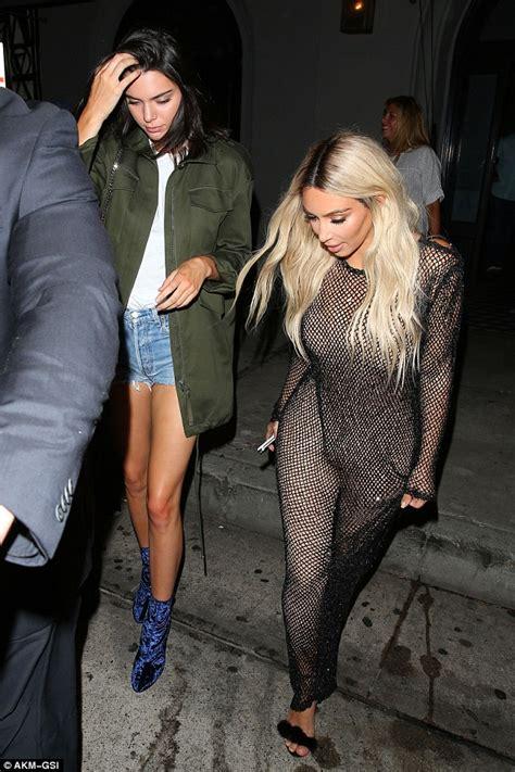 kim kardashian net jumpsuit daily mail kim kardashian wears skin tight mesh jumpsuit to party