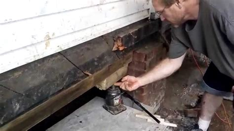 Lifting A Garage From The Foundation by Leveling A House Fix Sinking Foundation Level