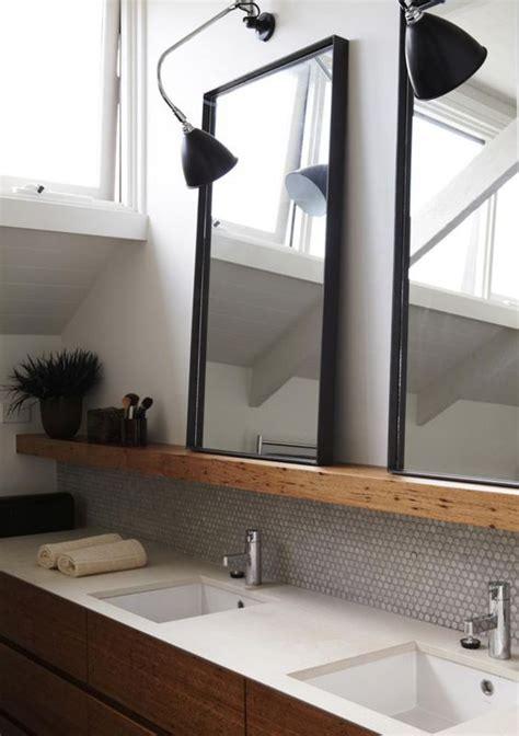 dark wood bathroom mirror wood cabinets white coutnertop shelf above sink dark