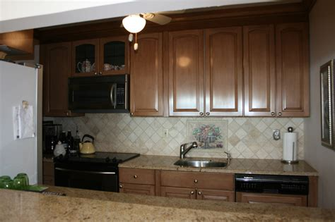 painted or stained kitchen cabinets paint or stain old kitchen cabinets