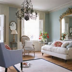 pale green living room with lilac stripe chair for the