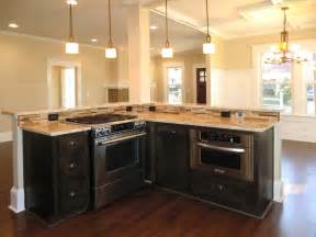 Island with jennaire downdraft stove and under counter microwave