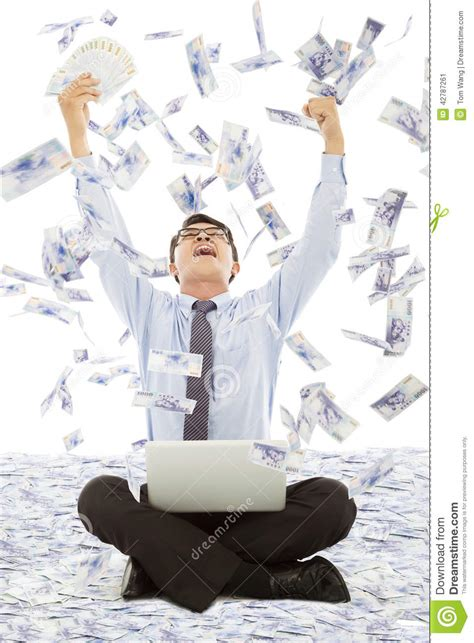 Winning With Money - business man winning a lottery with money rain background stock photo image 42787261
