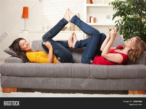 teens have on couch smiling teens lying on couch feet image photo bigstock