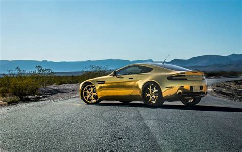 gold aston martin gold on gold aston martin vantage v8 with forgiato wheels