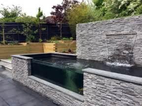 Backyard Swimming Hole Modern Sloping Garden With Feature Koi Pond Lush Garden