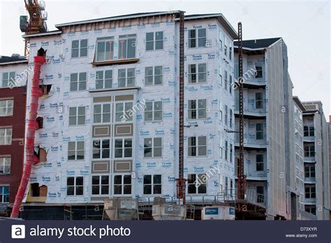 buy tyvek house wrap dupont tyvek protective building wrap applied in new construction stock photo royalty