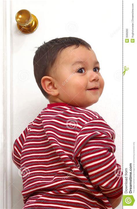 When Can A Baby Go In A Door Bouncer by Boy Entering Through Door Stock Photos Image 3589283