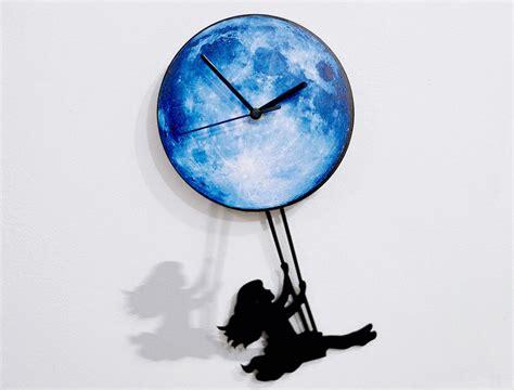 swinging on the moon girl swinging on the moon pendulum wall clock ebay
