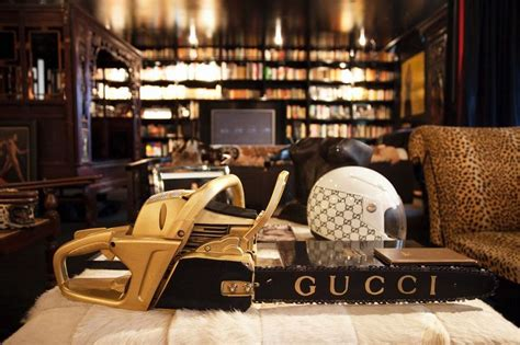 the infamous gilded gucci chainsaw of miss cindy gallop gucci is launching decor and we actually just fainted see