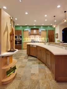 Curved kitchen island with quartz countertop warm wood tones a custom