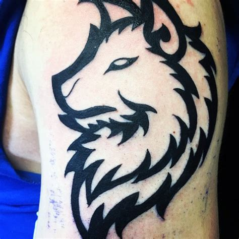 50 Tribal Wolf Tattoo Designs For Men Canine Ink Ideas Bold Tribal Forearm