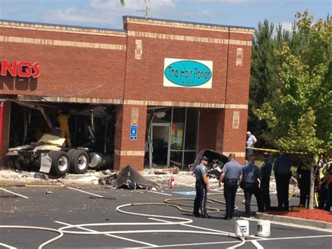 truck crashes into scenic highway shopping plaza driver