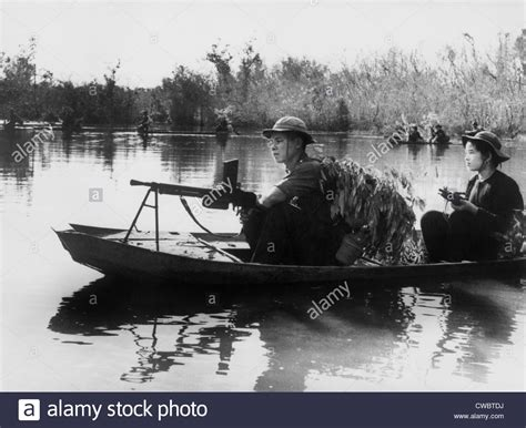 small boat vietnam viet cong guerrillas in small boats patrol the saigon