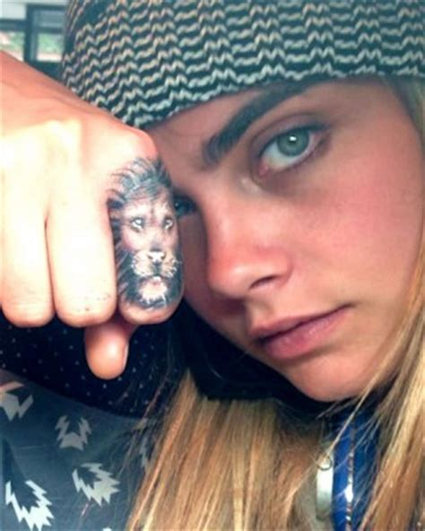 tattoo on finger lion cara delevingne tattoos meanings a complete tat guide