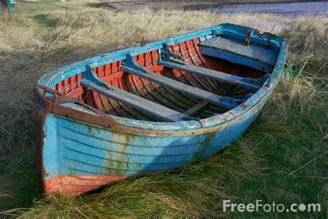 old boat blue book old boats photography old rowing boat holy island