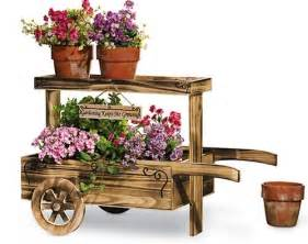 Rustic Wheelbarrow Planter by Rustic Wooden Wheelbarrow Planter Along The Garden Path