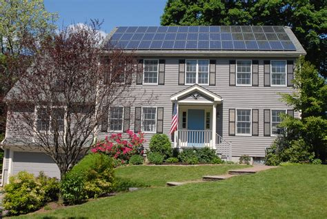 file solar panels on house roof jpg