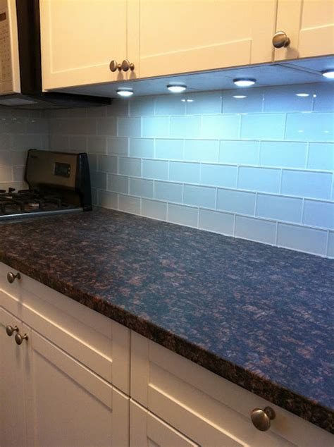 kitchen with white glass subway tiles backsplash