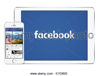 varna bulgaria february 02 2015 female hand holding white apple iphone 4 smartphone with facebook social networking