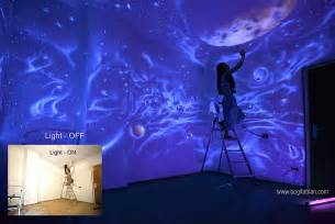 artist paints rooms with murals that glow under blacklight joanna perry top mural artist hand painting murals