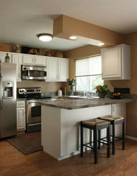 white solid wood small kitchen cabinet using grey marble countertop combined with ceiling