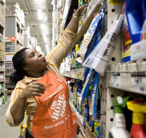 home depot leads the dow index higher the boston globe