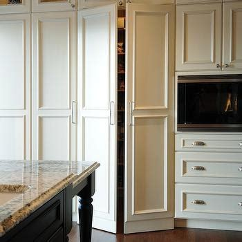 floor to ceiling storage cabinets with doors vaulted ceiling in kitchen transitional kitchen