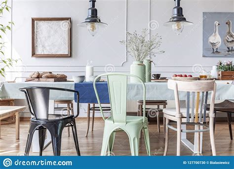 colorful chairs  table  eclectic grey dining room