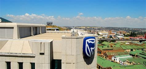 standard bank contacts office south africa s standard bank fined 32 6m by a
