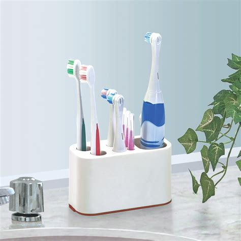 Toothbrush holder electric toothbrush toothpaste storage