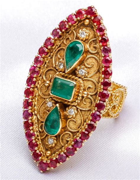 gold emerald and garnet ring