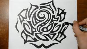 drawing a large detailed tribal rose head tattoo design