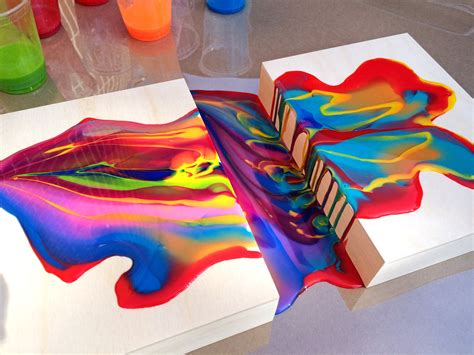 how to pour acrylic paint on canvas acrylic pouring medium connecting two wood panels