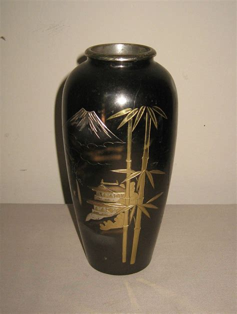 small japanese bronze vase with a of mt fuji from