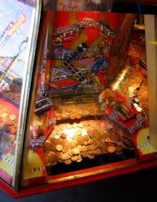 coin pusher arcade machine file arcade coin pusher detail jpg wikimedia commons
