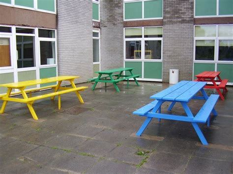 colourful  seater picnic tables  lunch time