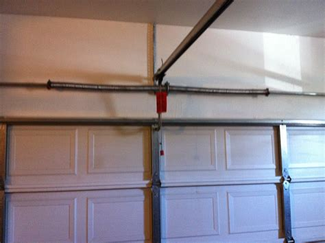 An Overhead Garage Door Has Two Springs by Garage Door Springs Is The Most Prone To Damage
