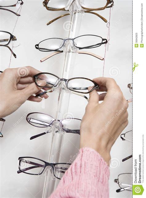 Womans Rack Choosing Eyeglasses From Rack Stock Photos Image