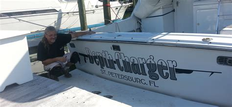 installing boat lettering vinyl boat names in greater ta bay friends of shell key