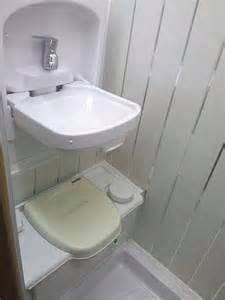 fold up bathroom sink toilet with fold up sink above for efficient use of space