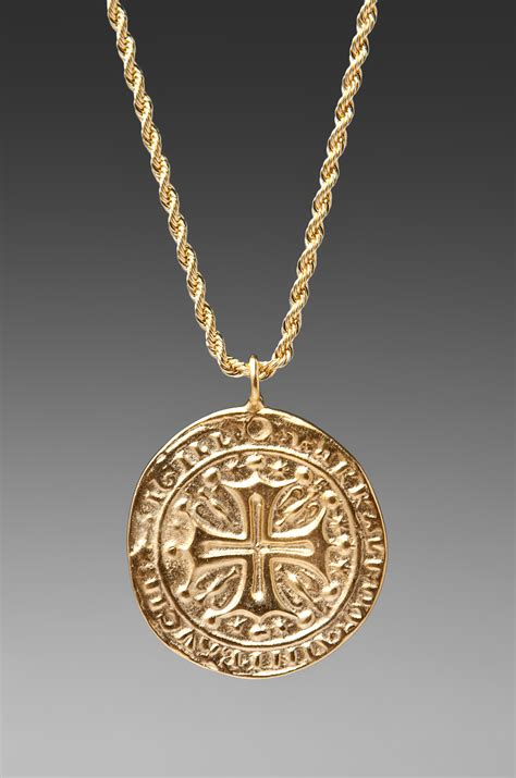 kenneth gold cross medallion necklace in metallic