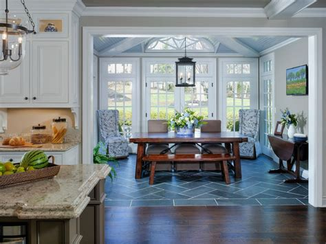 sunroom dining room ideas wood floor to tile transition dining room with traditional