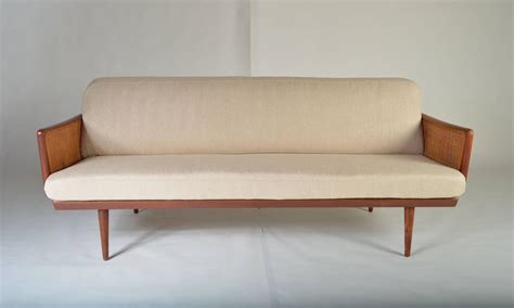 cane loveseat danish modern teak and cane sofa by peter hvidt at 1stdibs