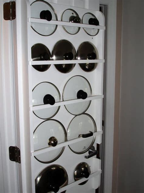 Kitchen Pan Storage Ideas S Remodeled Kitchen Purse Storage Creative And Pot Lids